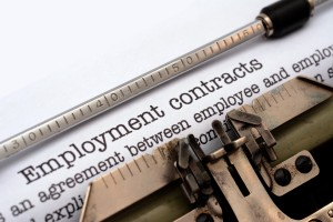 Typewriter with employment law advice contract
